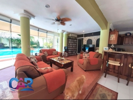 Living Room with walk-out to pool and covered patio