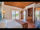 Master bedroom over looking the swimming pool and lake